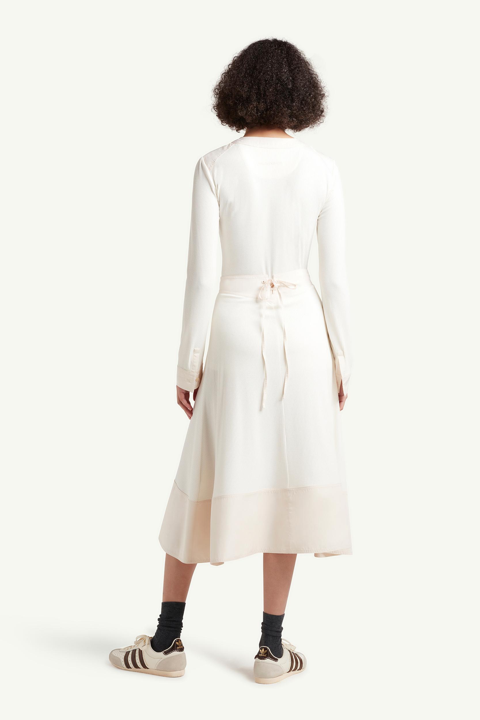 Back side shot of womenswear model wearing Wales Bonner Womenswear Model wearing a white long dress | LRP