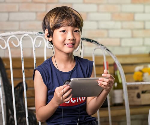 boy hearing via a device