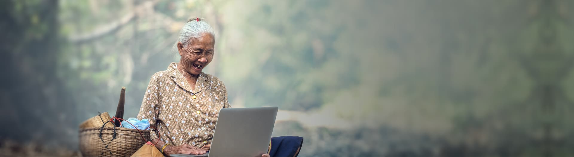 old lady smiling looking at computer