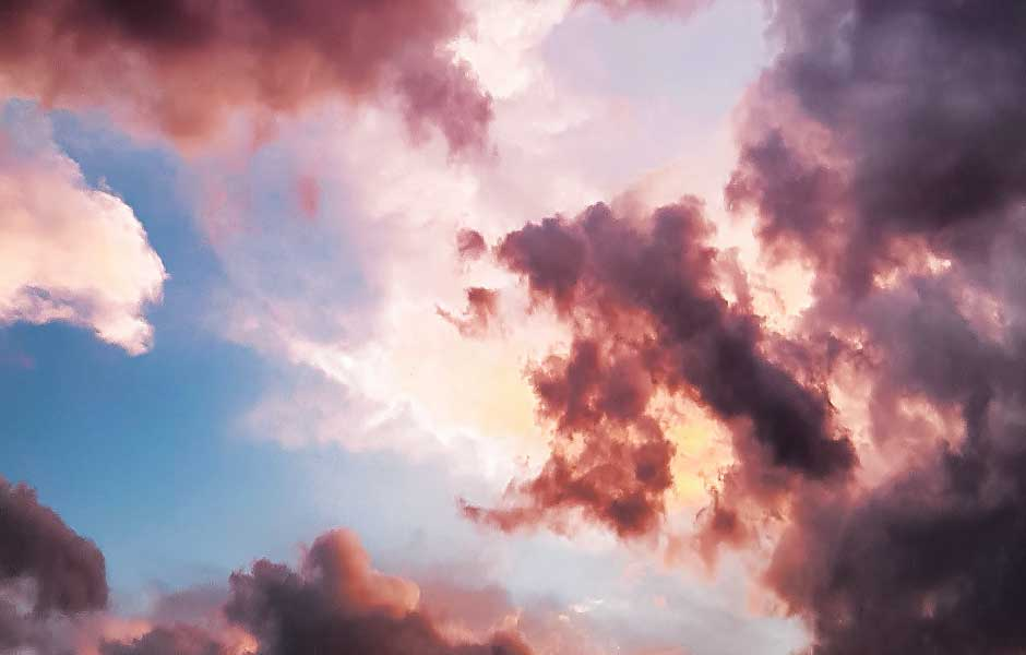 A cloudy sky with blue and pink hues.