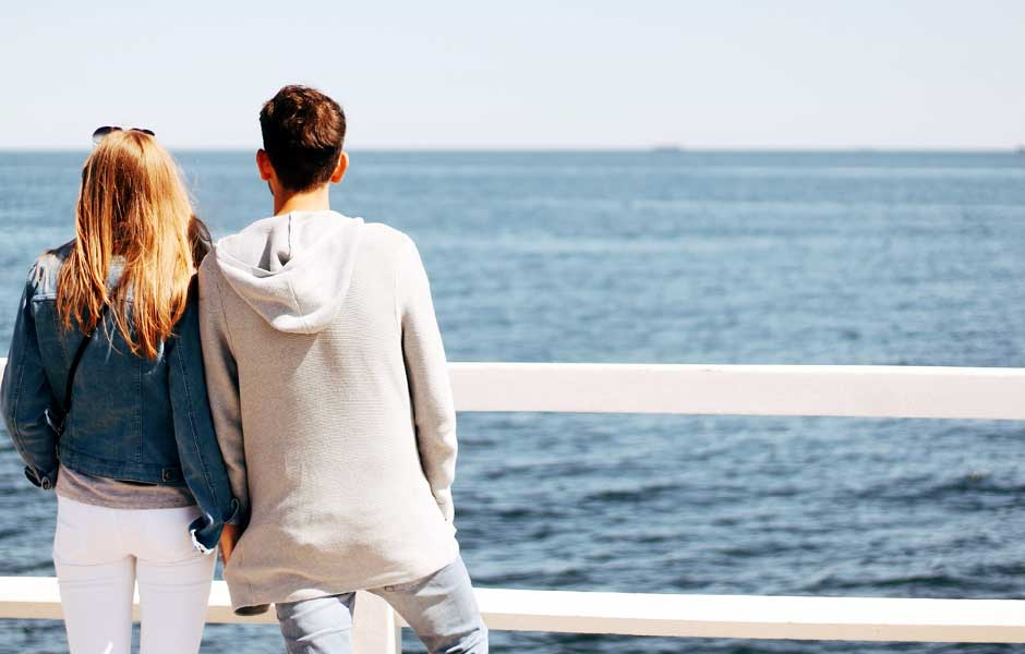 Couple overlooking a sea