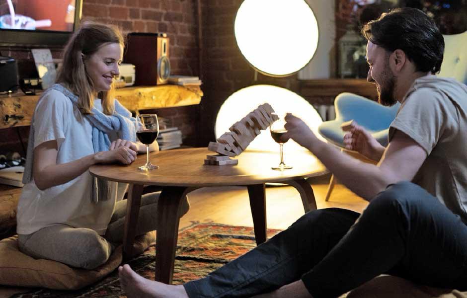 Couple playing Jenga together at home
