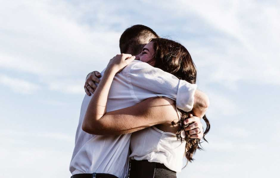 A man and woman hugging