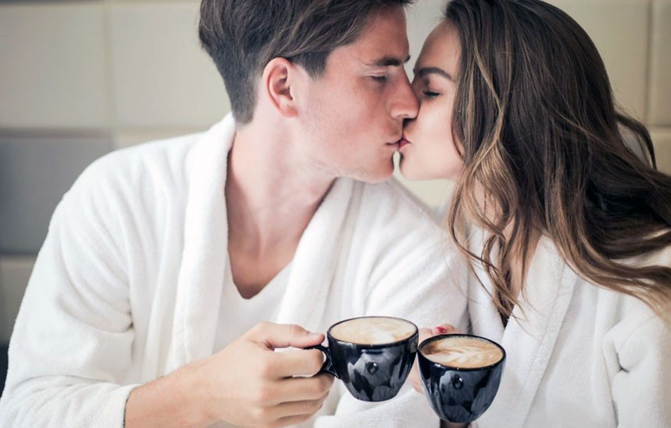 A couple drinking coffee together
