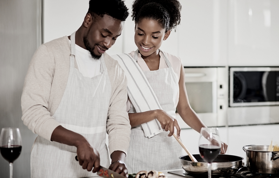 A couple cooking together and smiling
