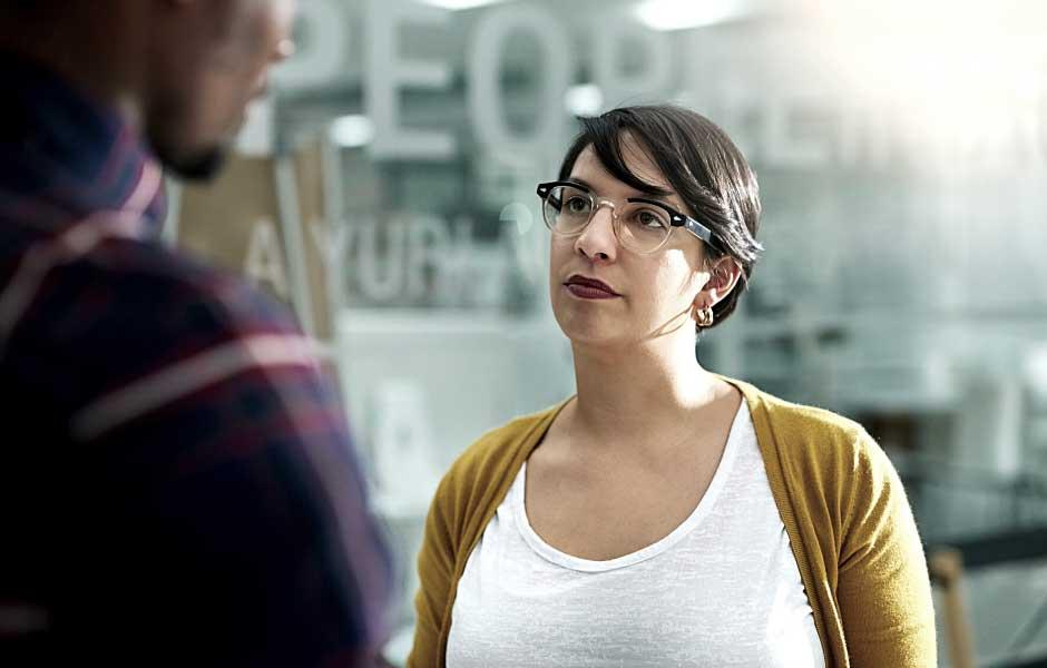Woman looking at man while talking