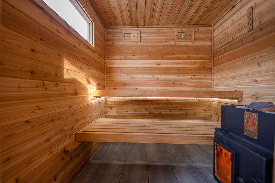Heat room and bench of a backyard sauna