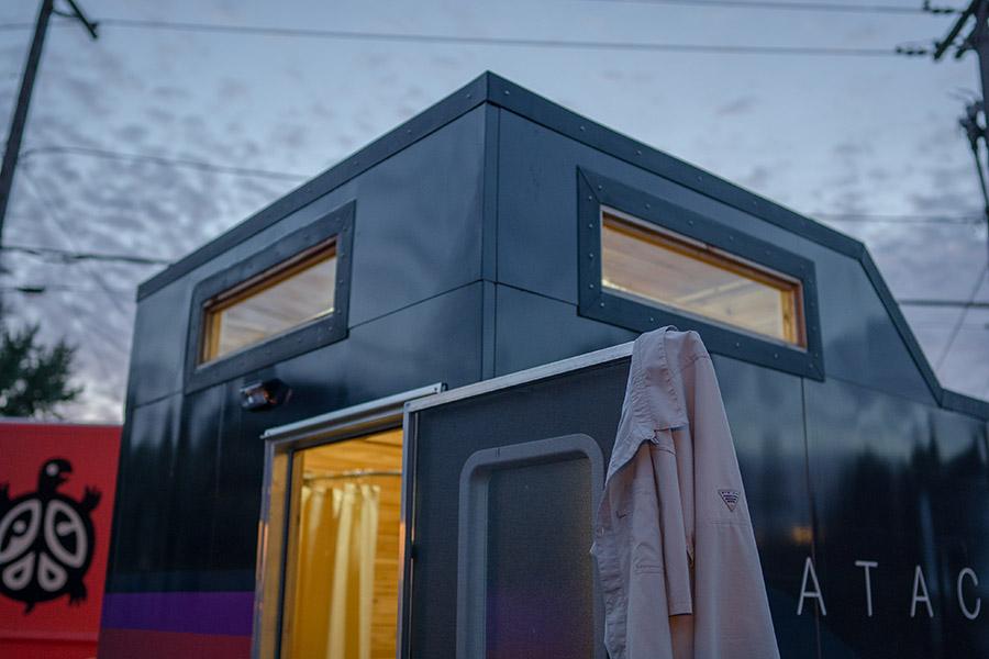 Top corner and door detail of a mobile sauna
