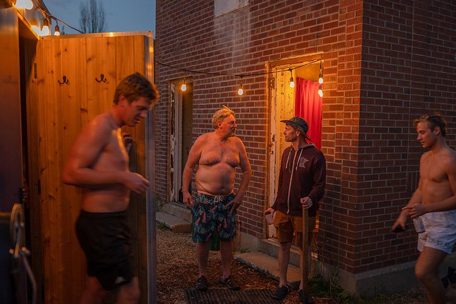 People talking around a mobile sauna