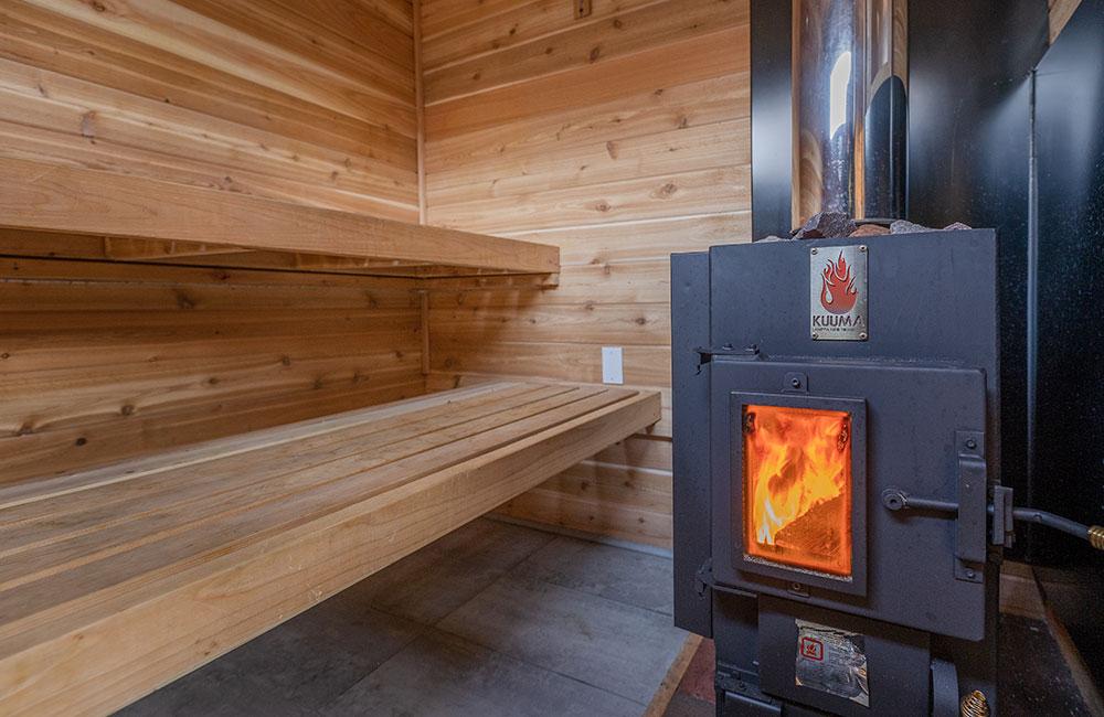 Sauna stove burning inside a sauna room