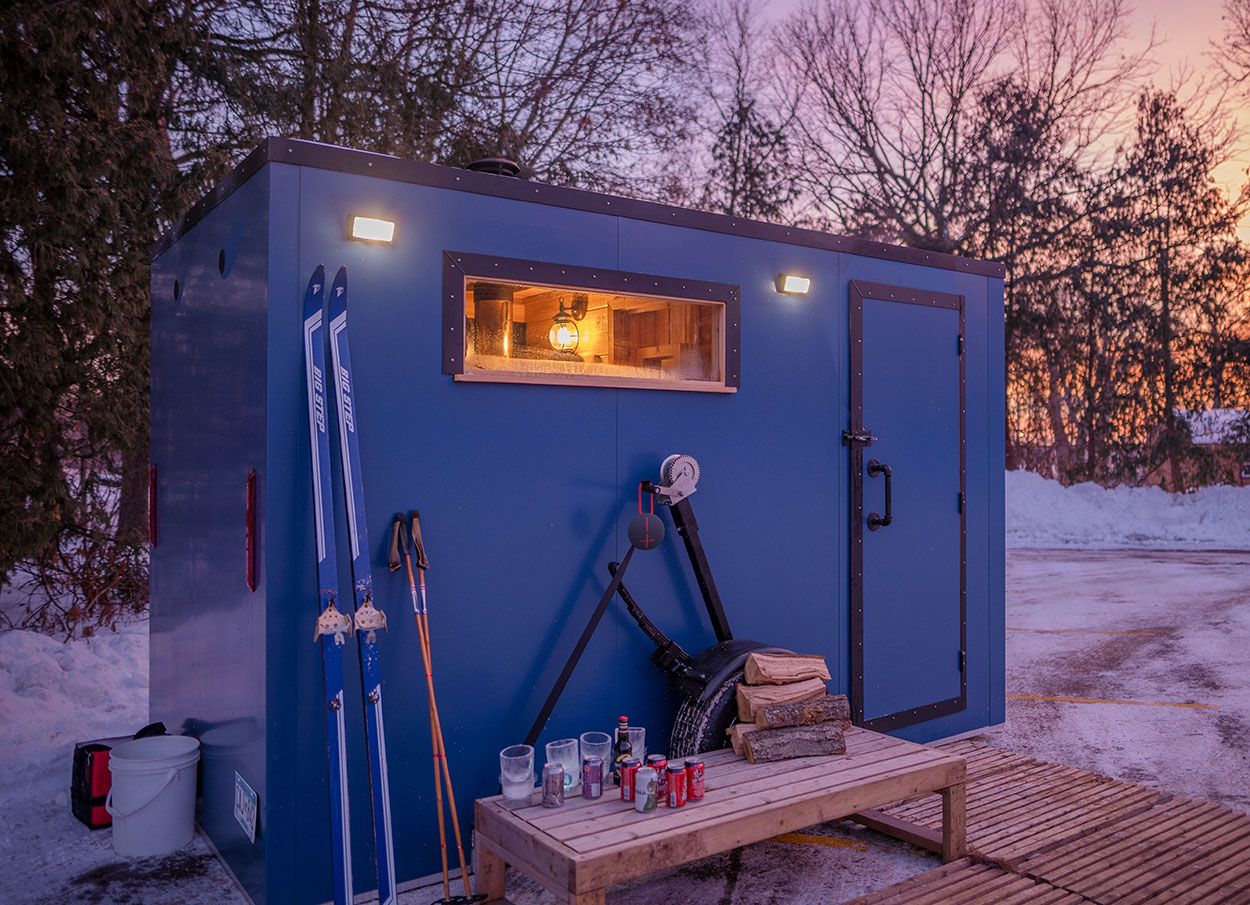 A mobile sauna parked outside during winter