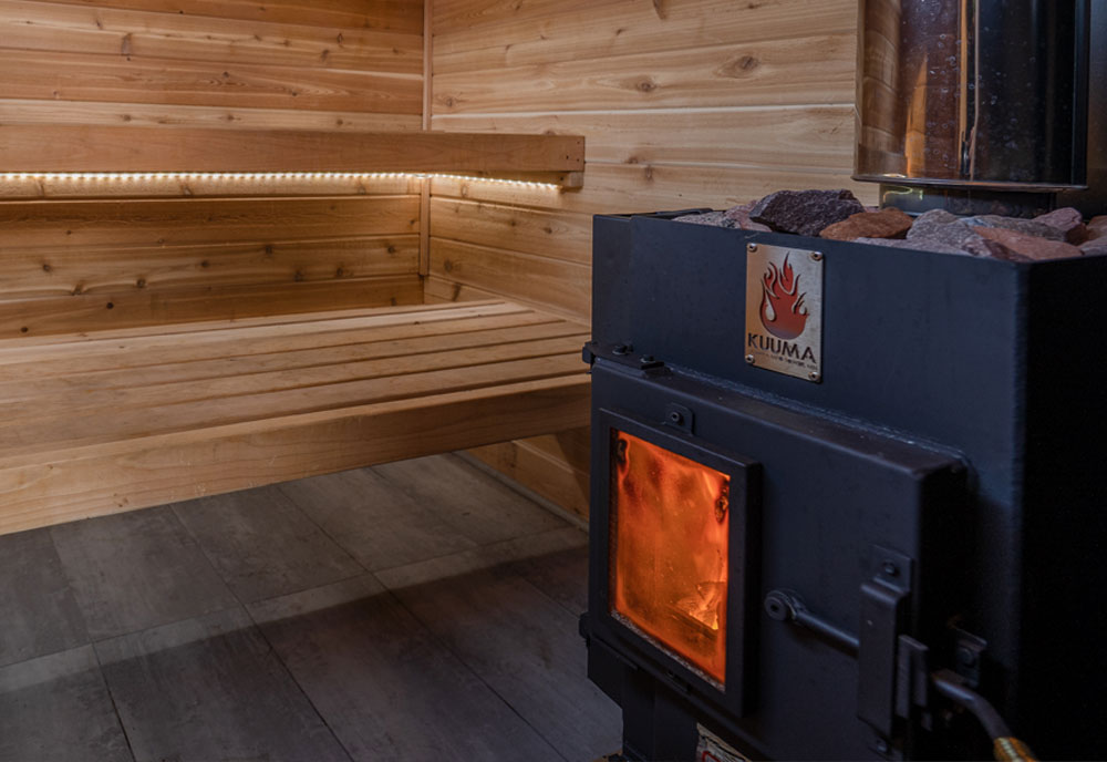 Wood fired stove burning inside a sauna
