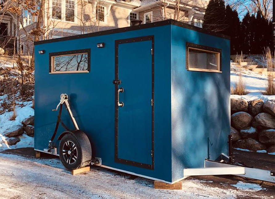 A mobile sauna parked on the street