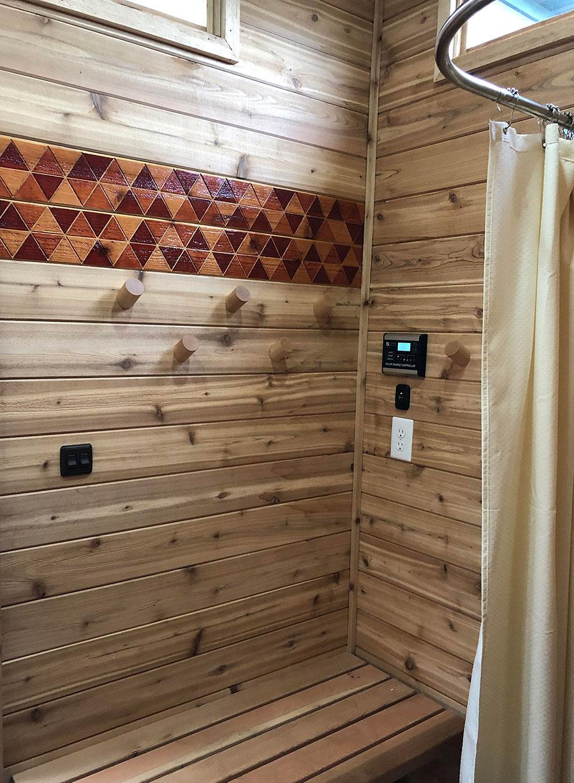 Shower area within a backyard sauna