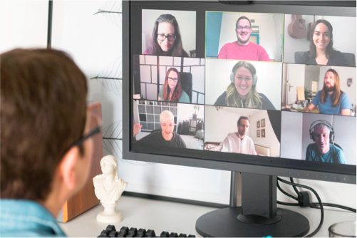 Person attending a virtual class on a zoom meeting