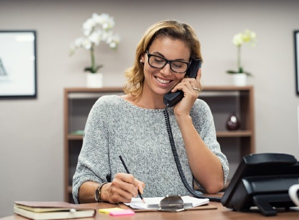 a woman talking on the phone at the front desk