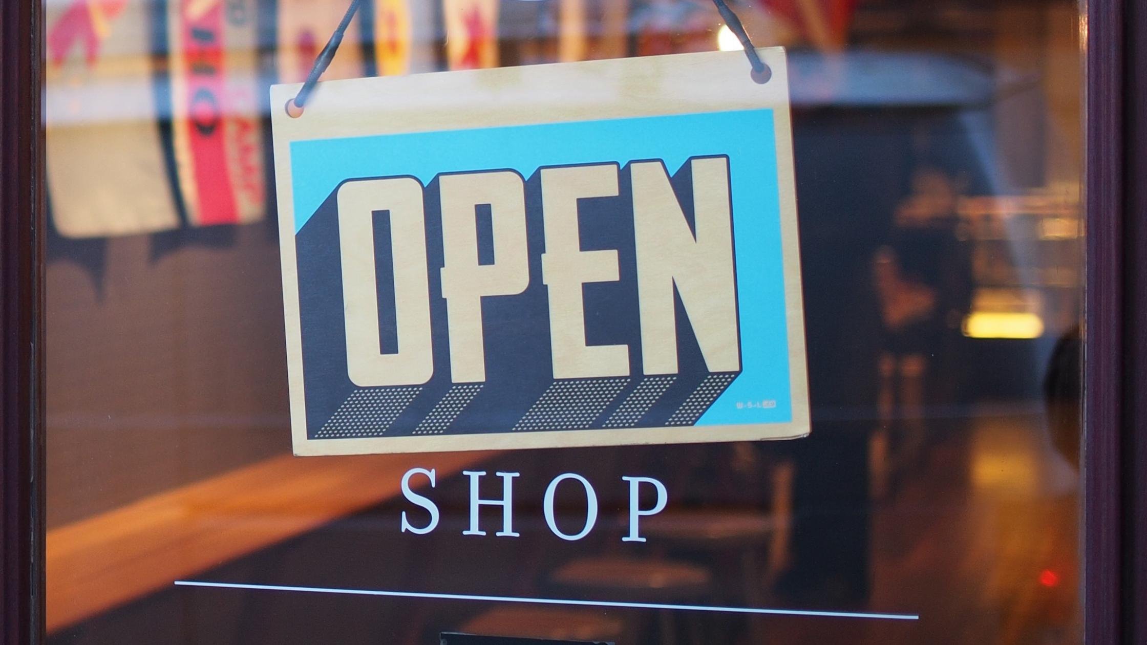 Open sign on a shop door