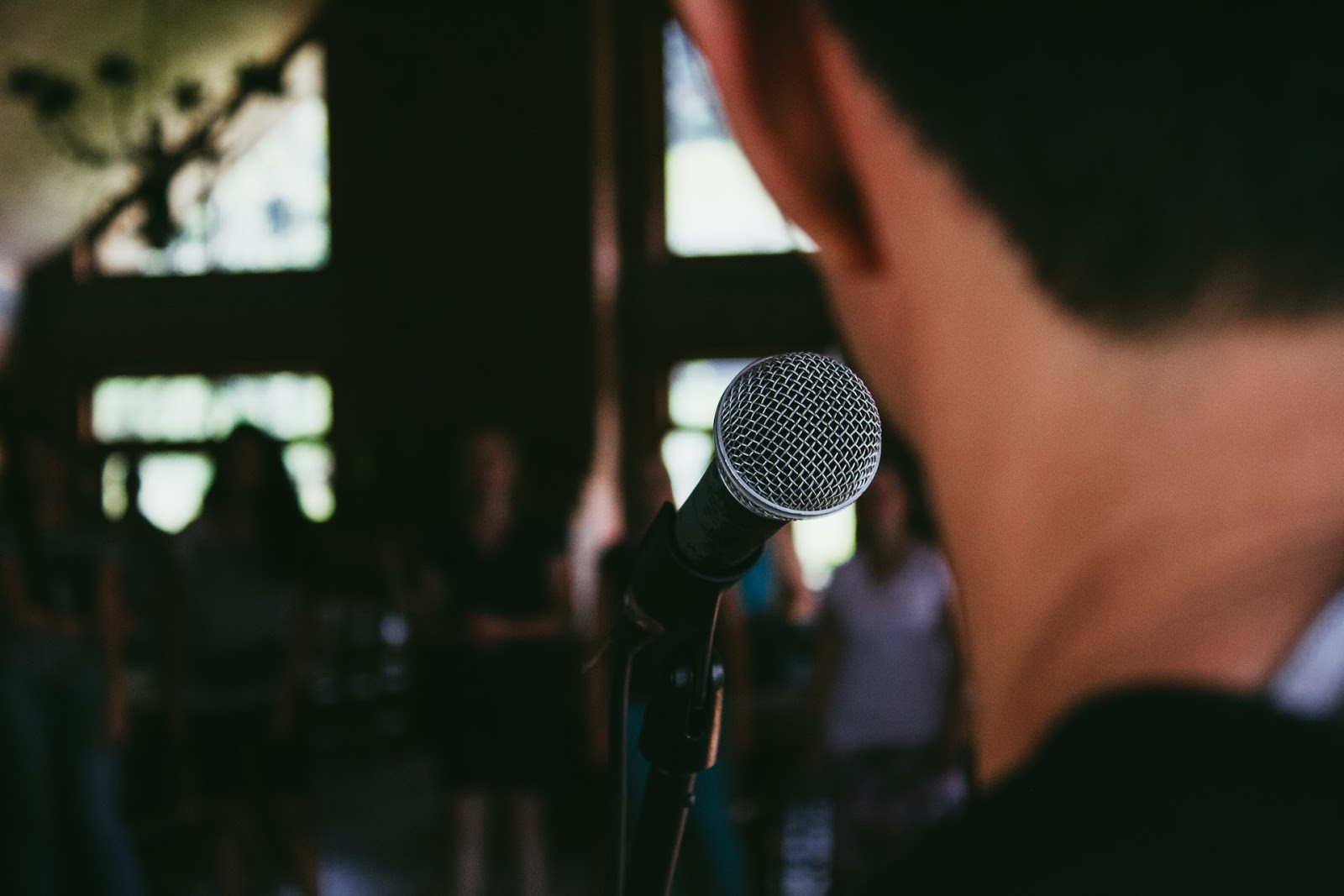 person speaking into a microphone