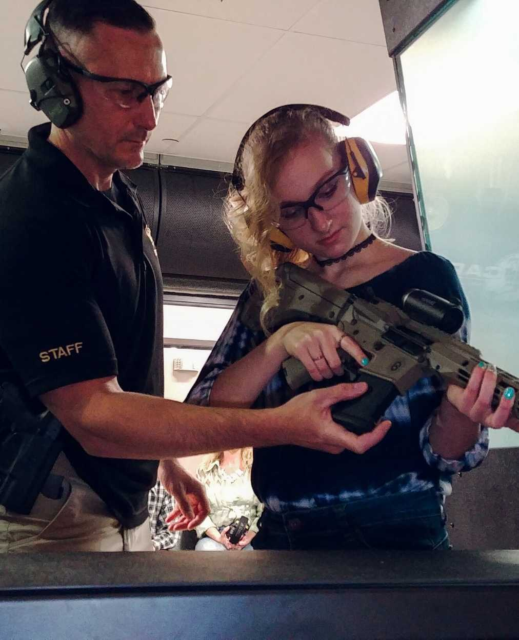 instructor-helping-girl-with-ar15