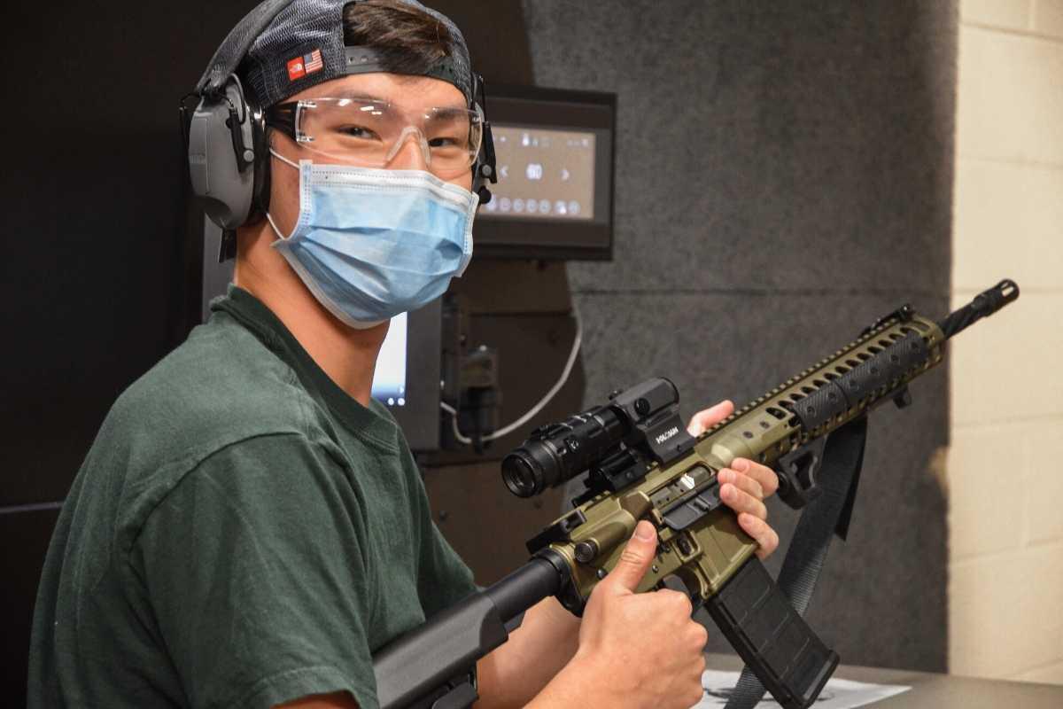 man-giving-thumbs-up-after-firing-rifle