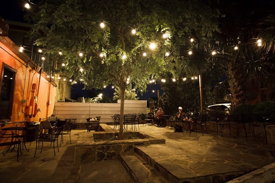 Image may contain: night, tree, plant, table and outdoor
