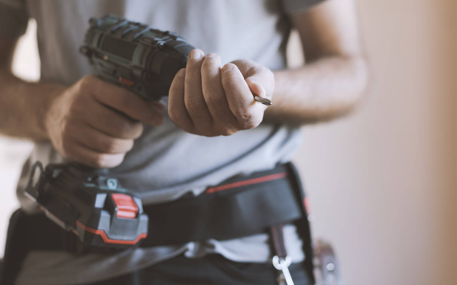 Man with drill carrying out refurbishment work