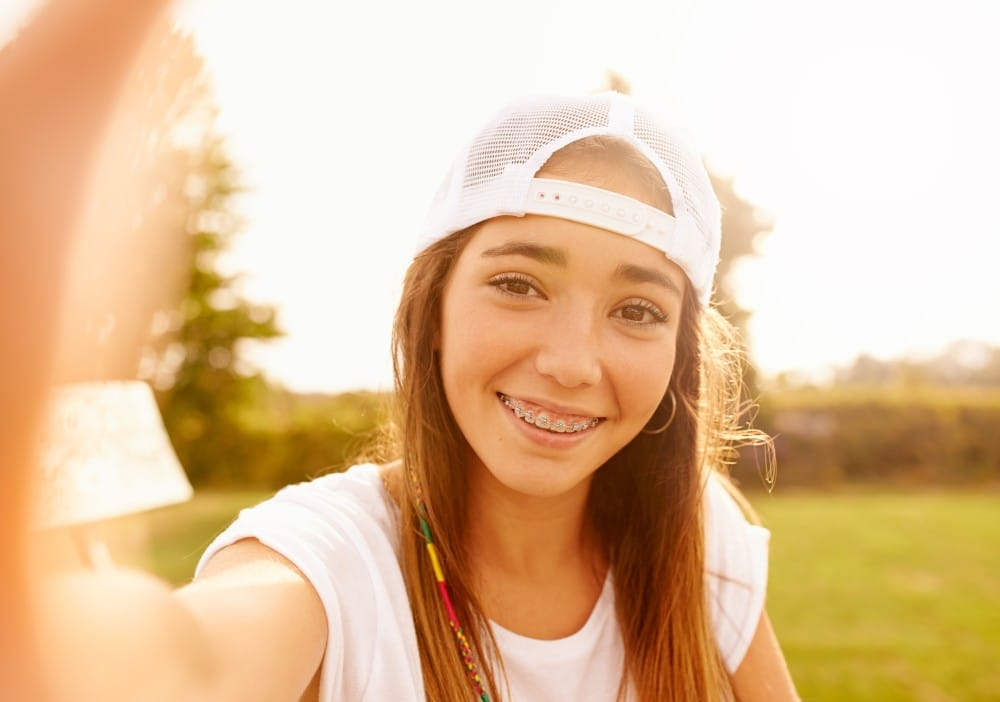 young teen with braces