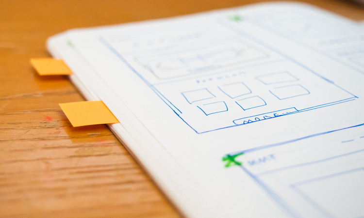 wireframe in notebook with post-its
