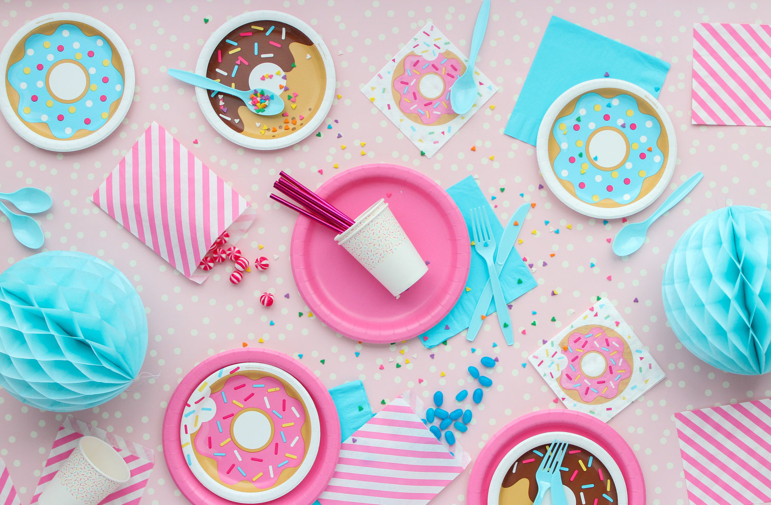 Colourful donut themed party supplies flatlay