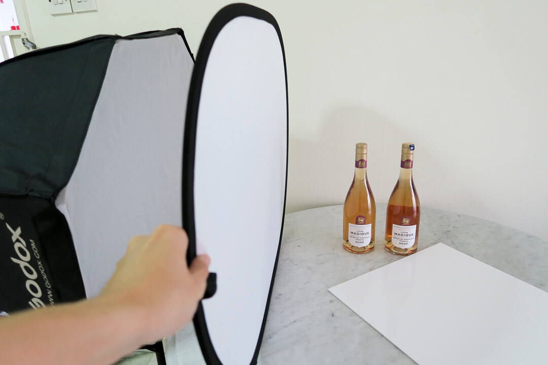 behind the scenes of rose wine bottle with diffuser lighting