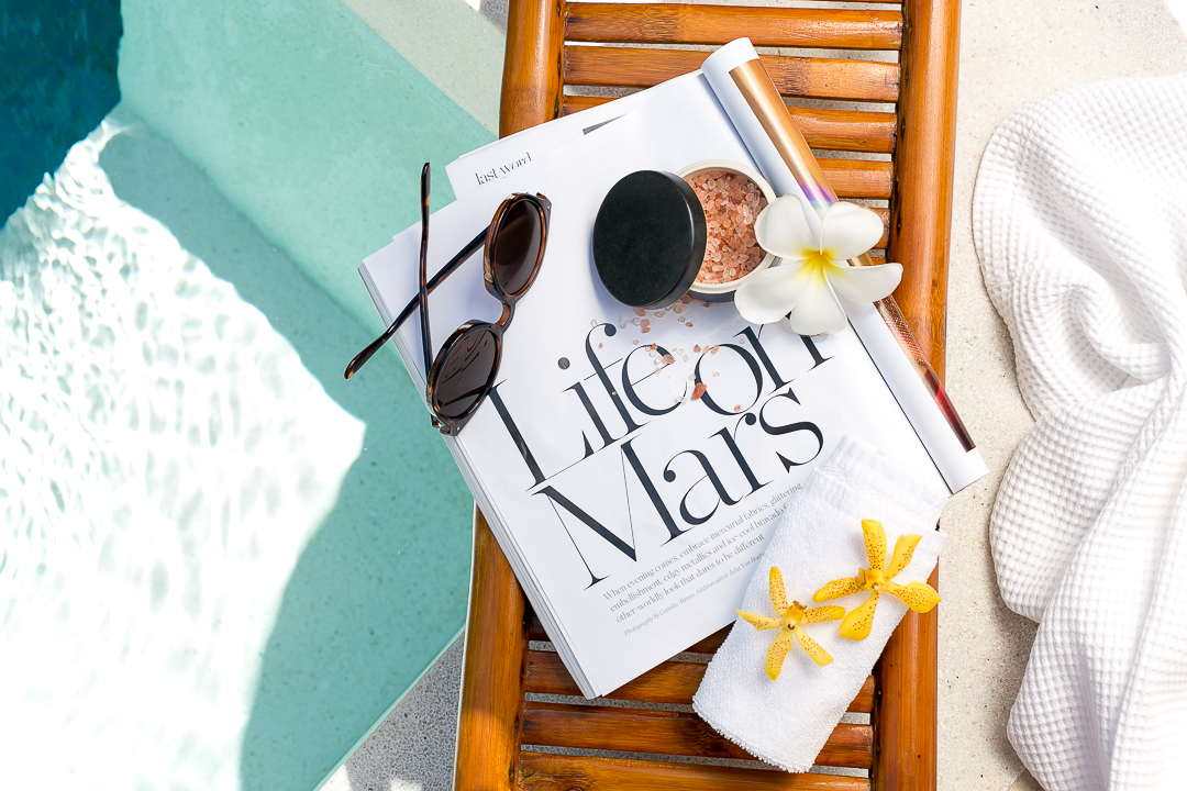 poolside relaxing with magazine and sunglasses