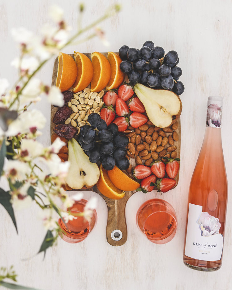 Fresh fruit and nuts platter served with rose wine