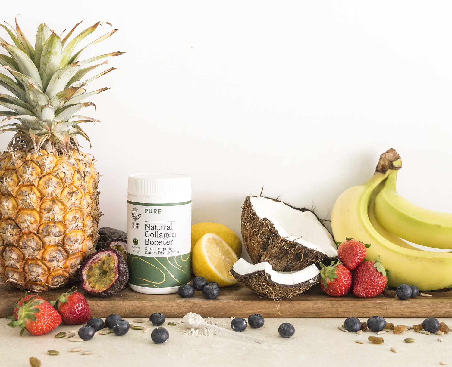 natural collagen booster surrounded by fresh tropical fruits and berries