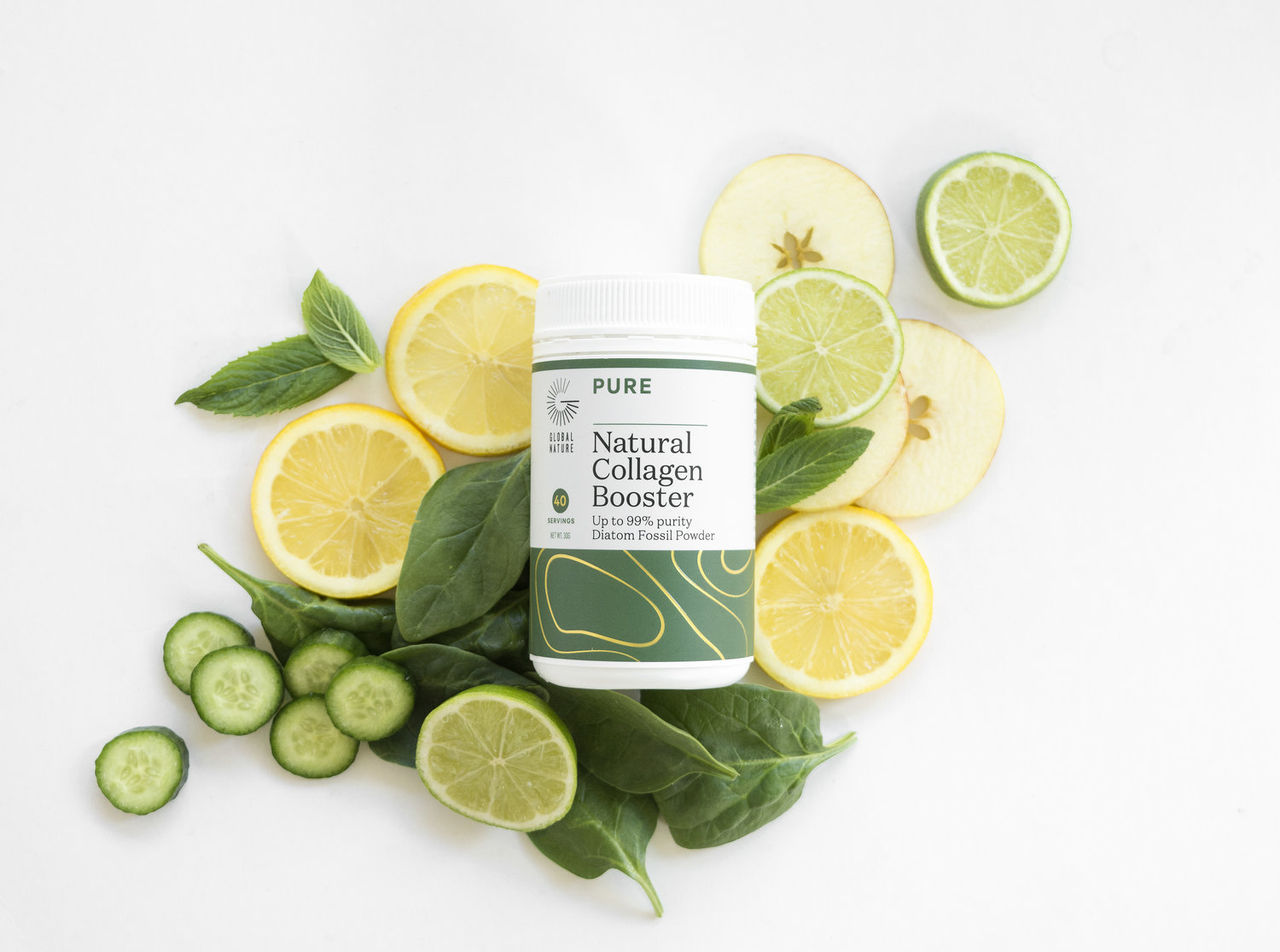 Natural collagen booster styled with citrus slices of lemon lime spinach and cucumber
