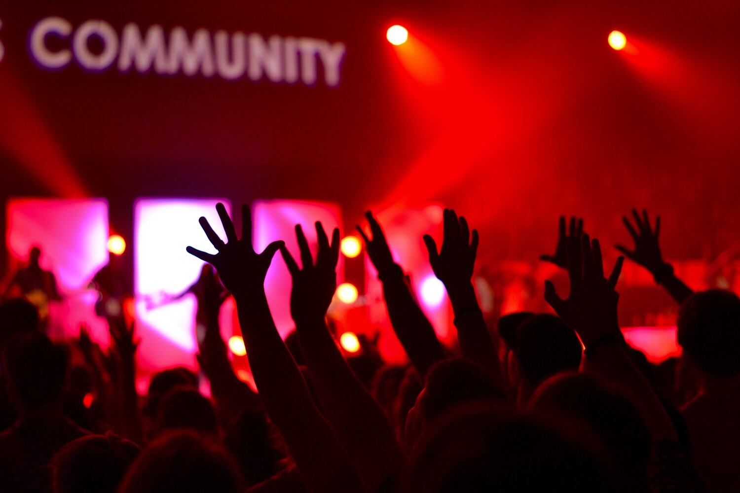 raised hands of a crowd at a community event