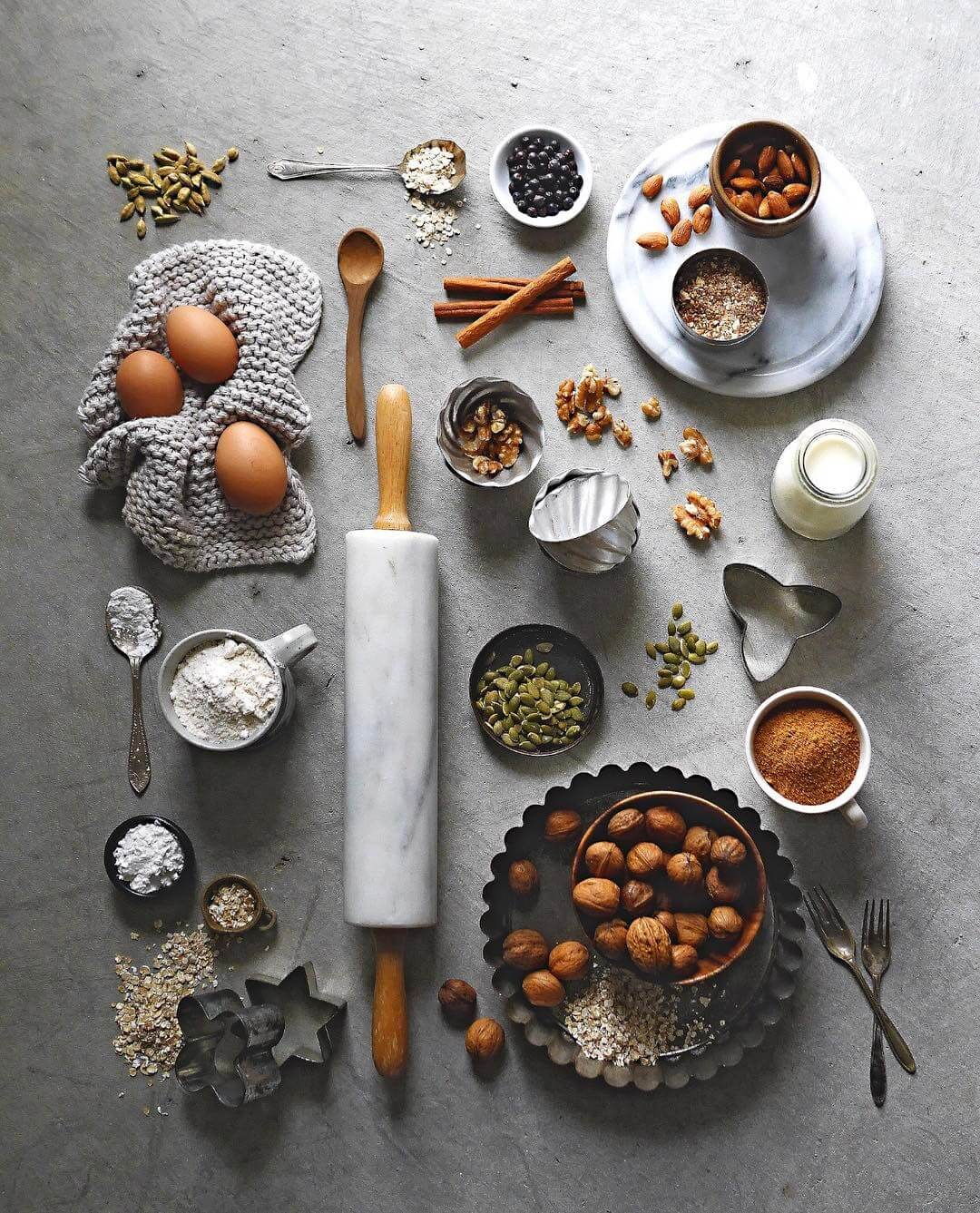 flatlay arrangement with cooking utensils, ingredients and spices