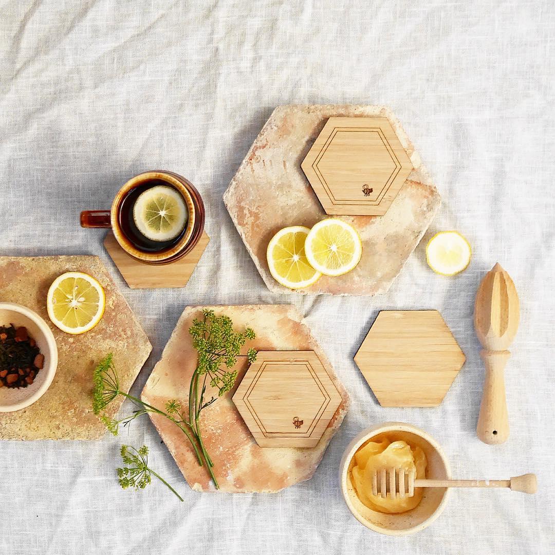 fresh lemon tea and honey on hexagonal coasters and wooden trivets
