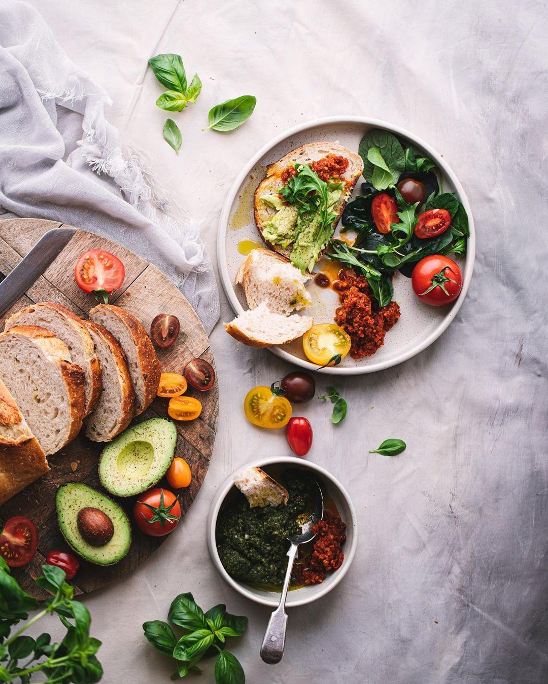 breakfast platter with bread, pesto, avocado, tomato and spinachs
