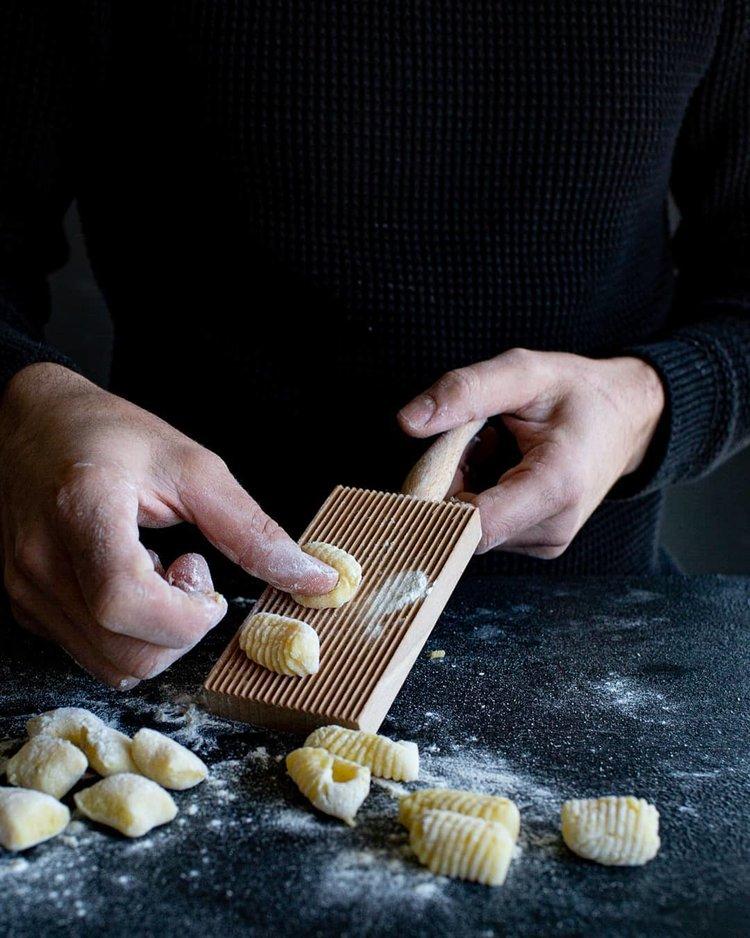 pressing fresh homemade gnocchi