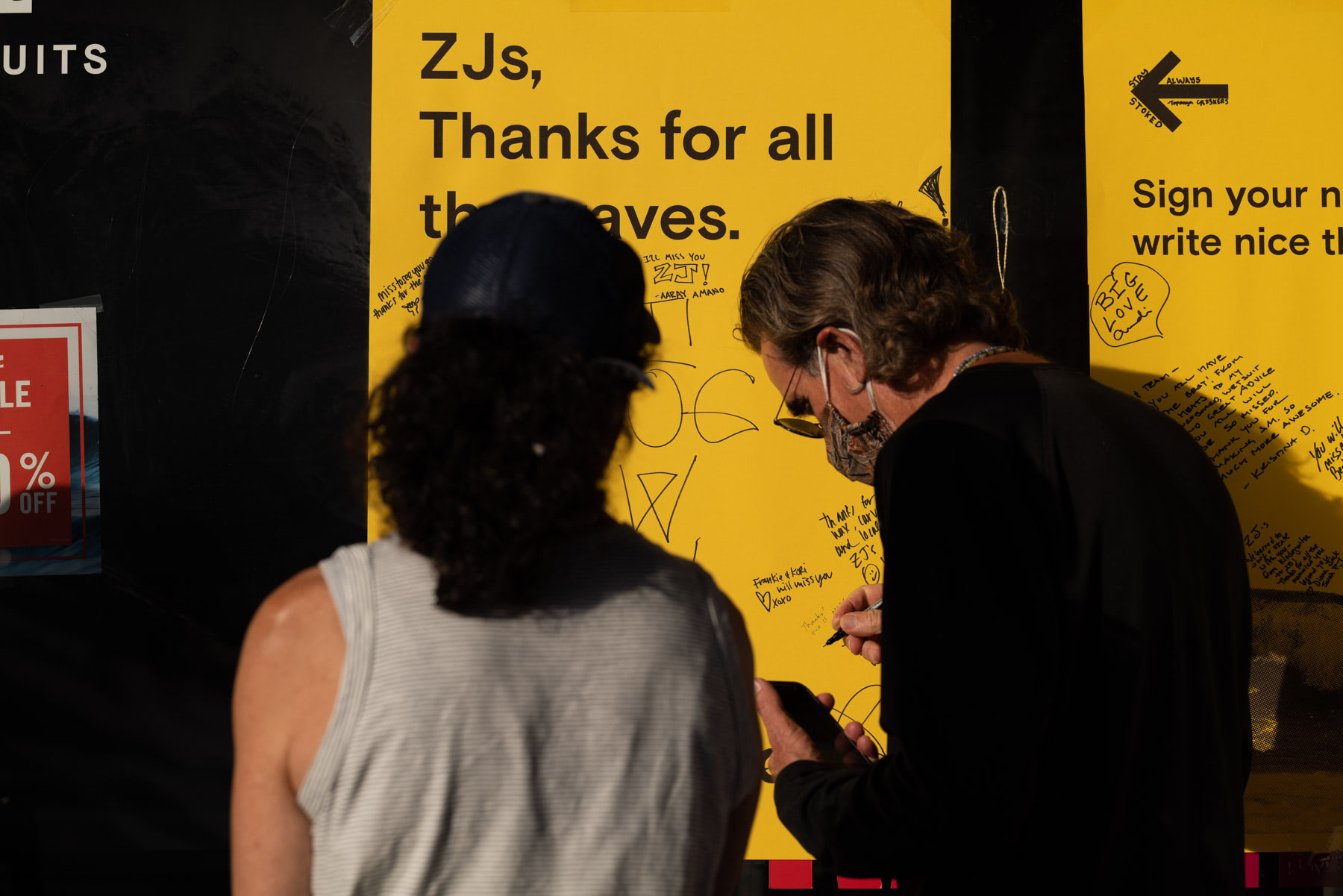 zjs boarding shop closing writing on poster