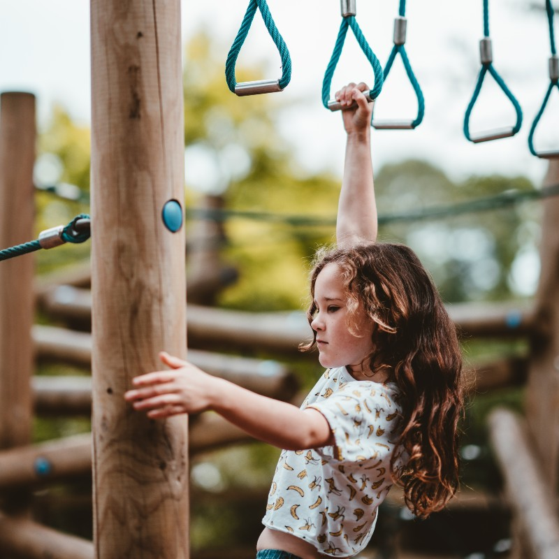 a girl playing on the playground