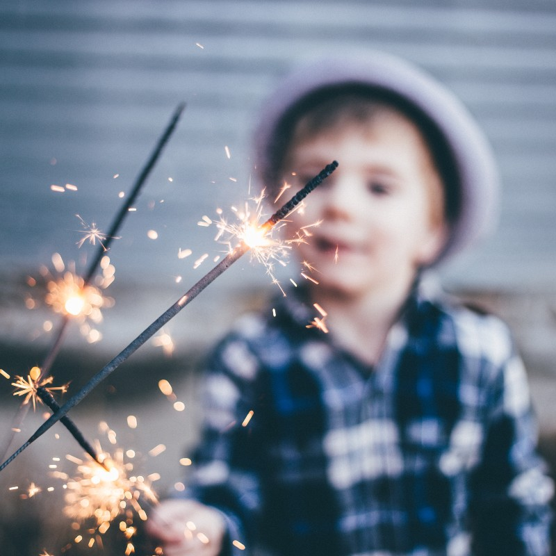 a little boy with sparklers