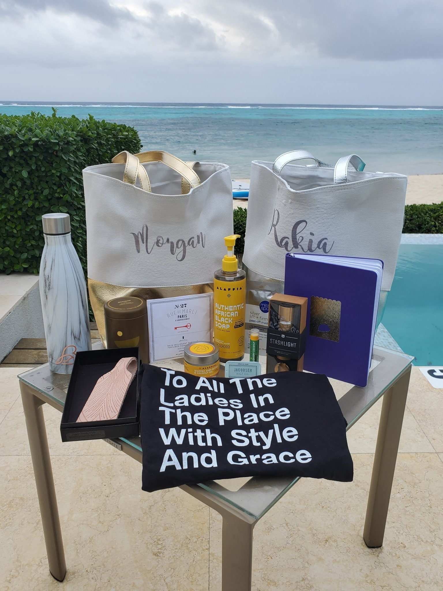 Several tote bags and beauty products sitting on a table outside.