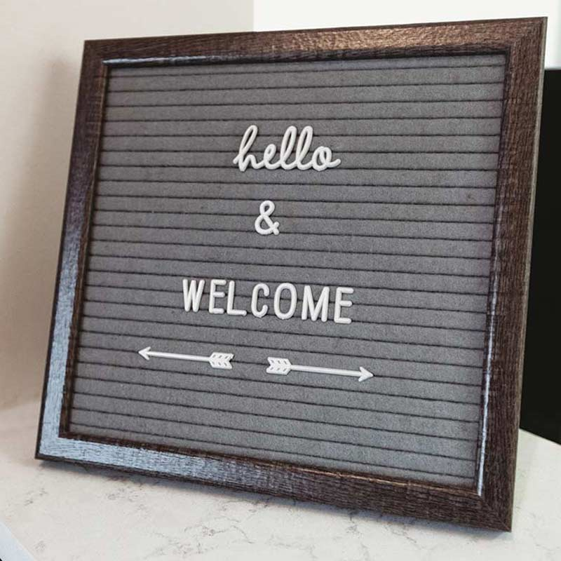 "Photo of a sign that reads, ""Hello and welcome"""