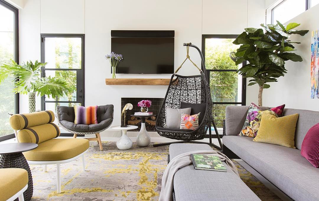 A living room interior using contrasts in color, form and texture to add depth and impact.