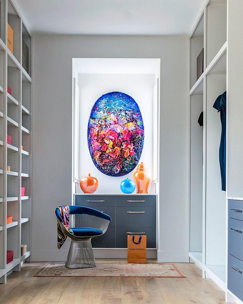 A high contrast interior space using a complementary color scheme with blue and orange.