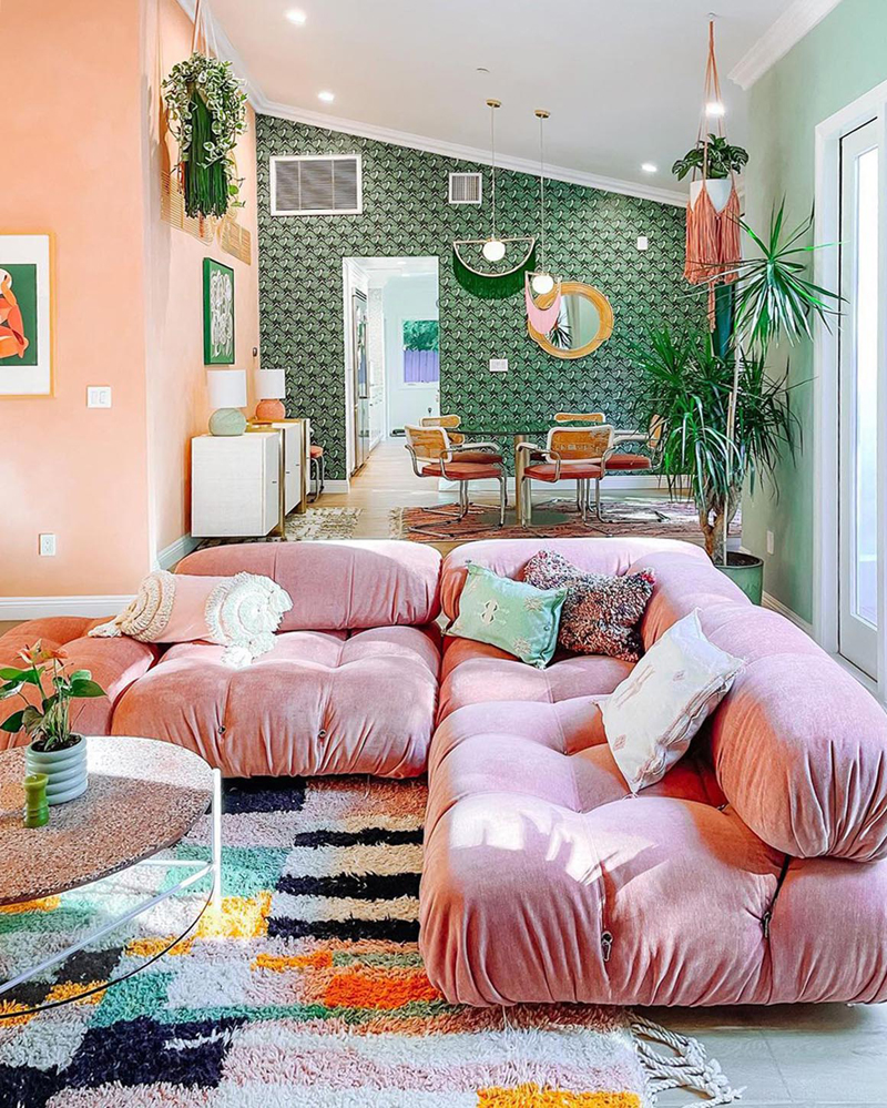 A colorful interior using contrasting greens, pinks and patterns.