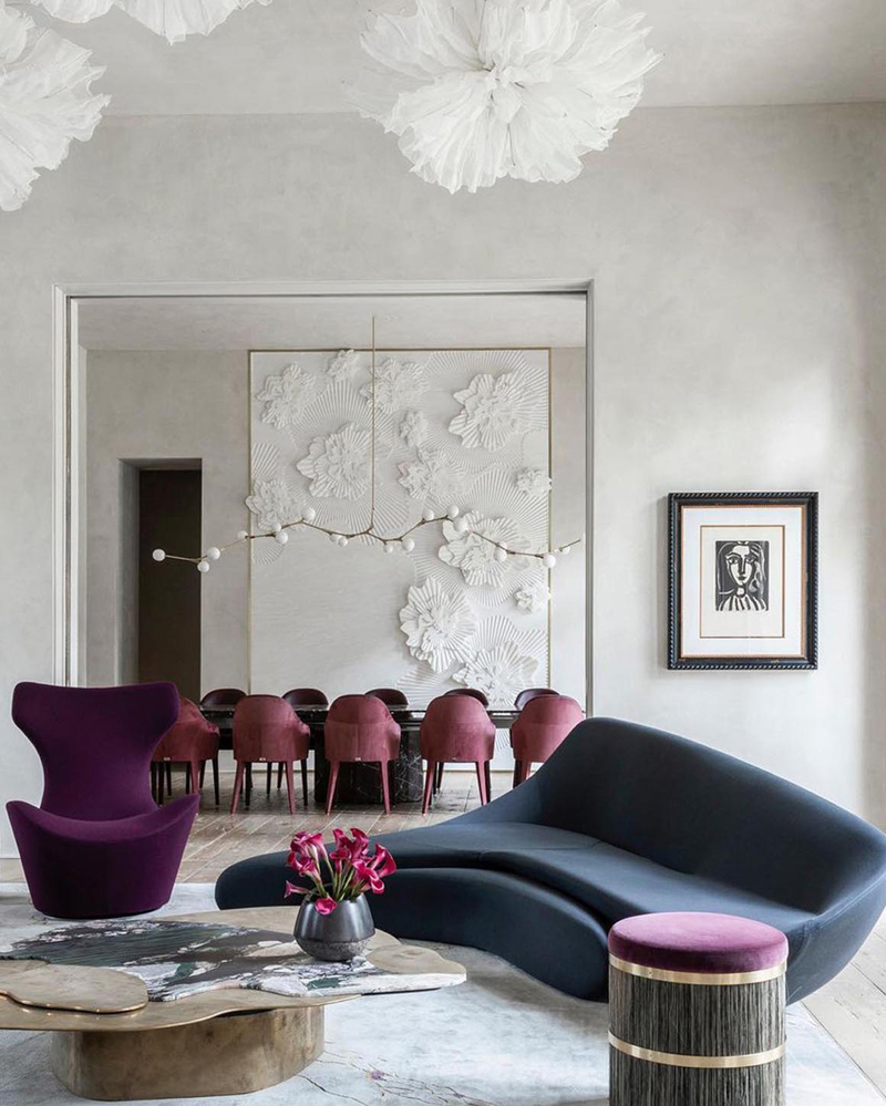 Interior design of an impressive living area using principles of contrast in form, shape, color and texture.