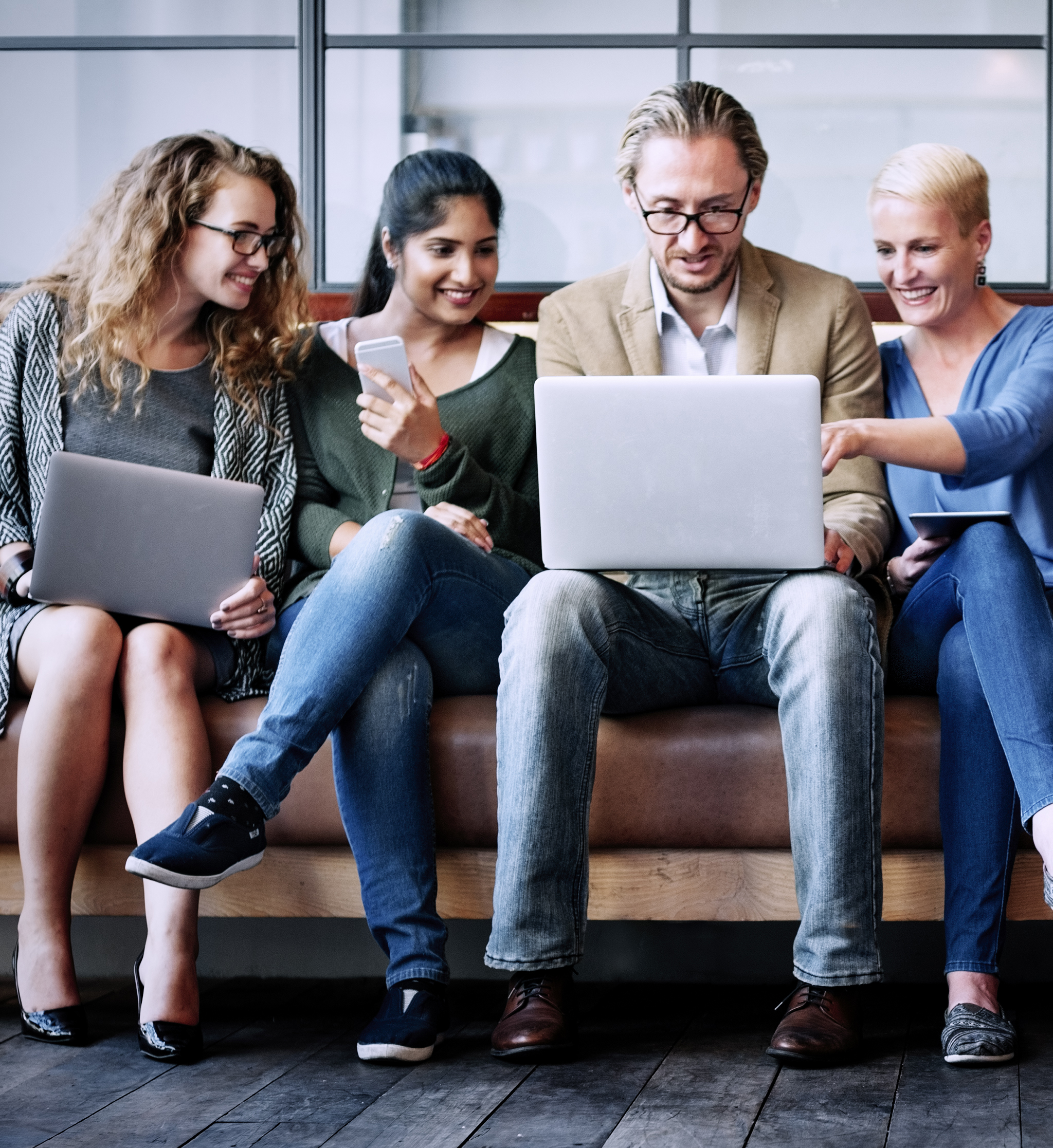 Diverse Group Looking At Laptop