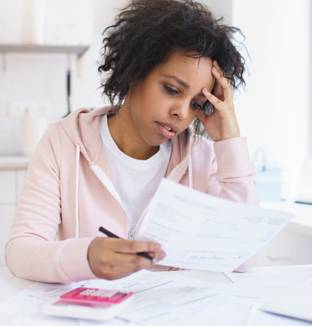 Outline of frustrated woman reading a document